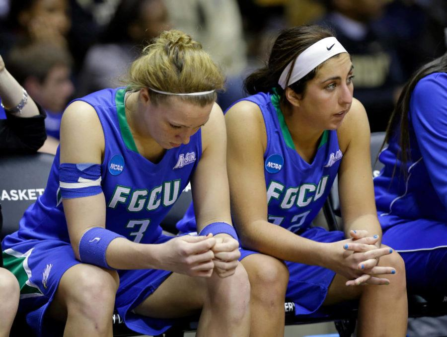Florida+Gulf+Coast+forward+Katie+Meador%2C+left%2C+and+guard+Stephanie+Haas+sit+on+the+bench+in+the+closing+seconds+of+the+overtime+period+against+Oklahoma+State+in+a+first-round+game+in+the+NCAA+women%27s+college+basketball+tournament+in+West+Lafayette%2C+Ind.%2C+Saturday%2C+March+22%2C+2014.+Oklahoma+State+won+61-60+in+overtime.+%28AP+Photo%2FMichael+Conroy