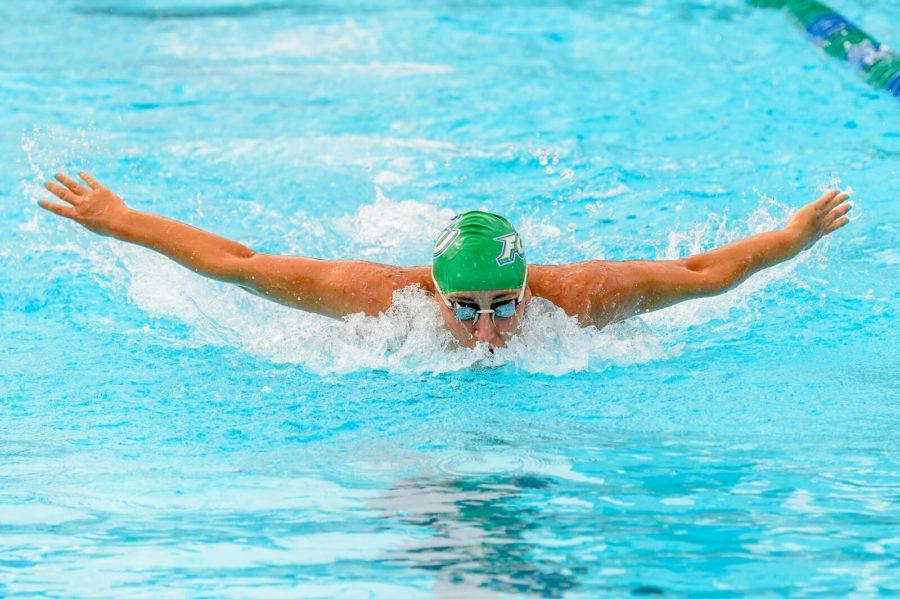 Junior+Devon+Robins+swims+in+a+meet+against+UNF.+Photo+by+Linwood+Ferguson.