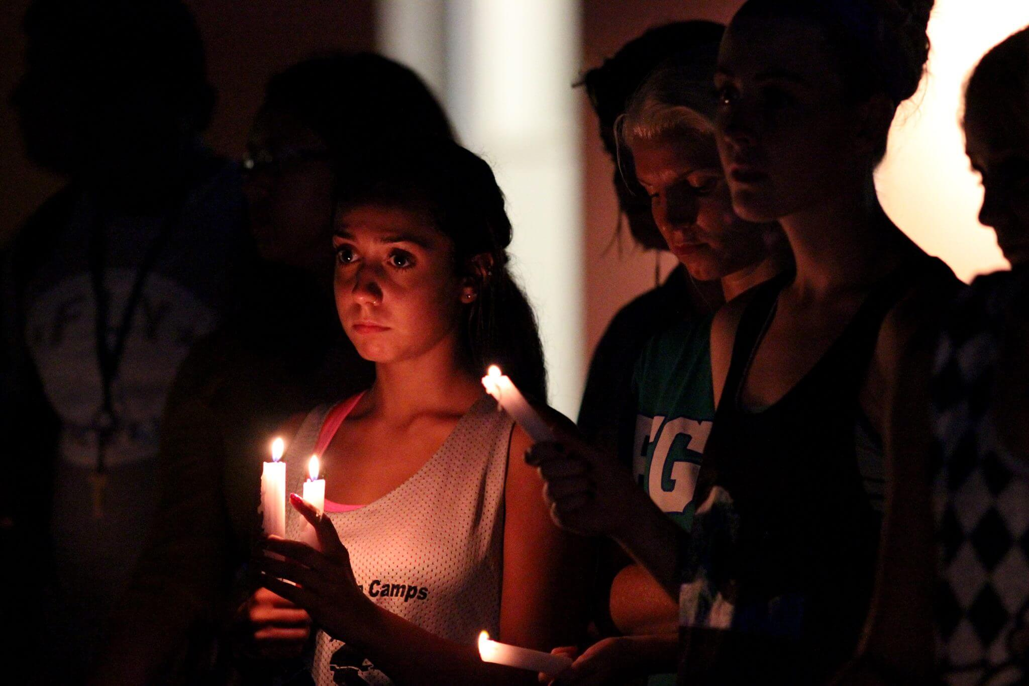 Candlelight vigil held  for student found dead