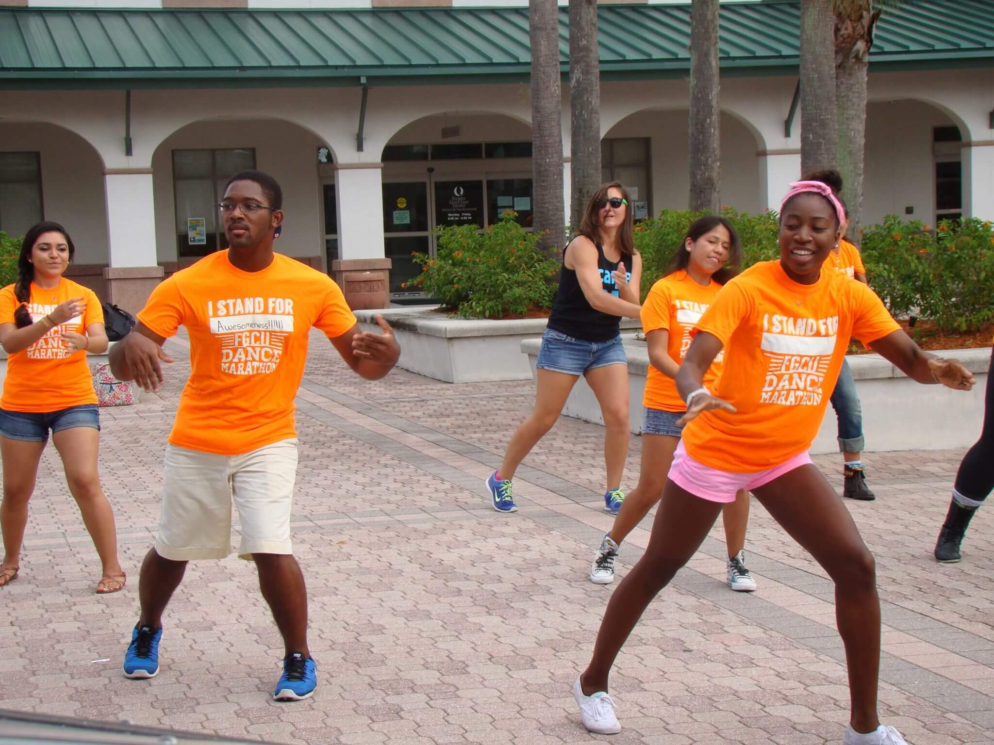 Dance Marathon mob flashes Student Plaza