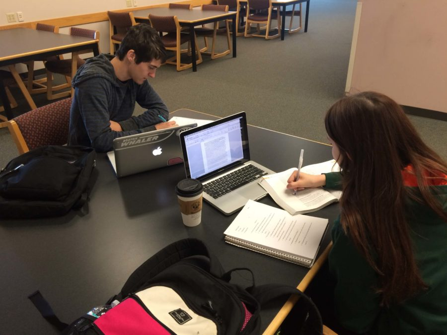 Maribel Gomez and Bradley Thomson study in the library during finals week.