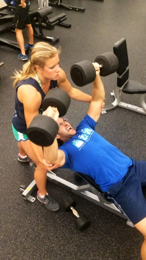 Stephen+Giuffrida+bench+presses+dumbells++while+Kathryn+Brewer+spots+him+through+his+last+set