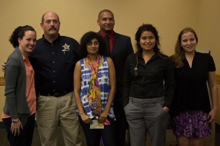 """From left, Victoria Kelly, Detective Henchesmoore, Dr. Nairruti Jani, Alex Olivares, Rachel Brown and Coral Martin at the """"Enslaved"""" event hosted by the Human Trafficking Resource Center."""