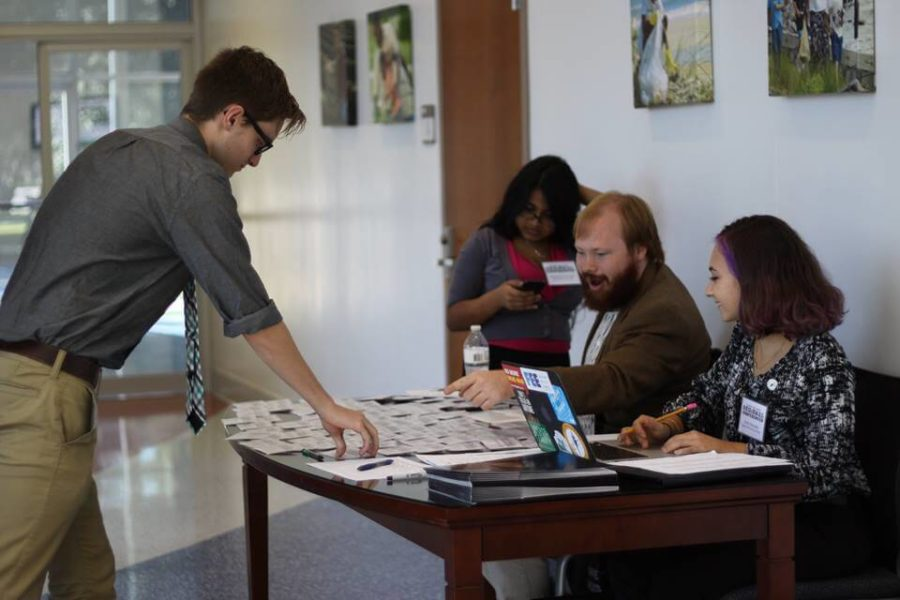 Students for Liberty volunteers Keegan Connolly and Emily Reynolds help conference attendees sign in at the University of Florida in September. Special to Eagle News.