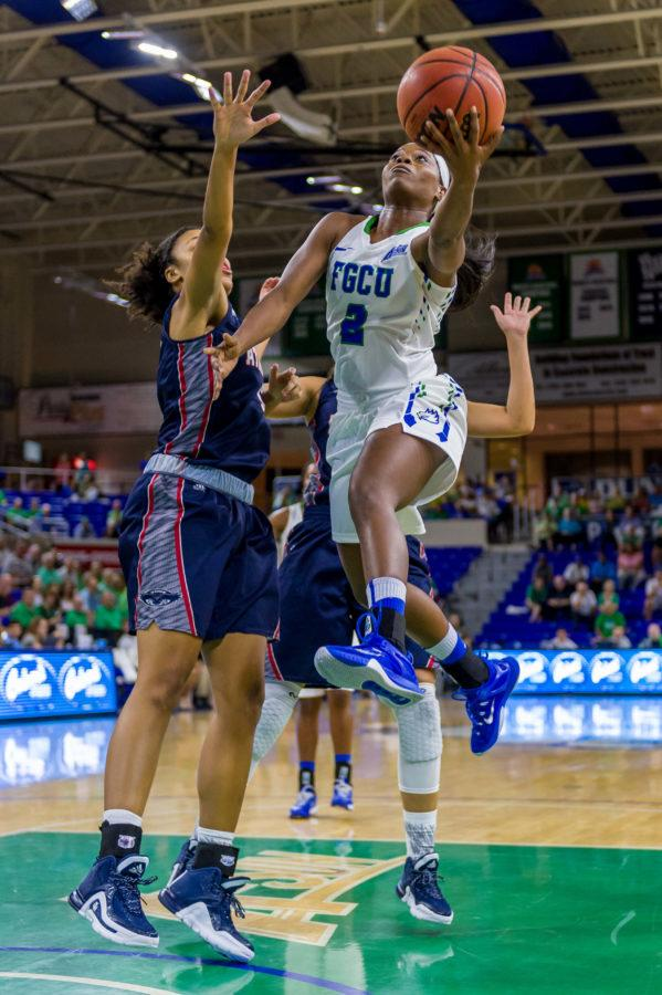 Kaniesha Atwater leaps for a layup during a recent home game. (Photo: Linwood Ferguson)
