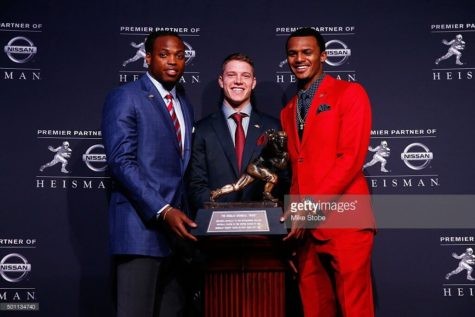 NEW YORK, NY - DECEMBER 13:  The Heisman Trophy sits on a stand before a press conference at the New York Marriott Marquis on December 13, 2014 in New York City.  (Photo by Alex Goodlett/Getty Images)