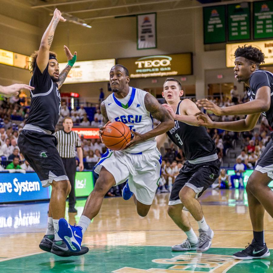 FGCU guard Zach Johnson drives toward the paint during Saturdays game against USC Upstate. (Photo by Linwood Ferguson)