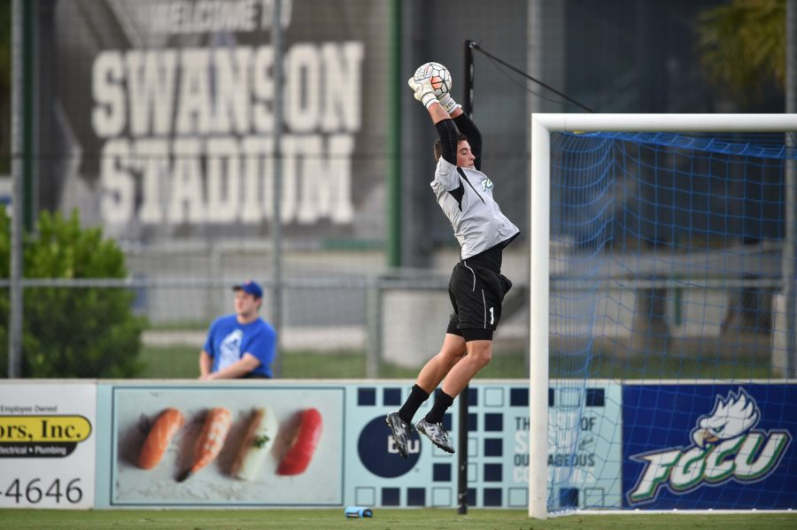 FGCU goalkeeper Nathan Ingham leaps for a save prior to a home game during the 2015 season. (Photo by Rick De Palva)
