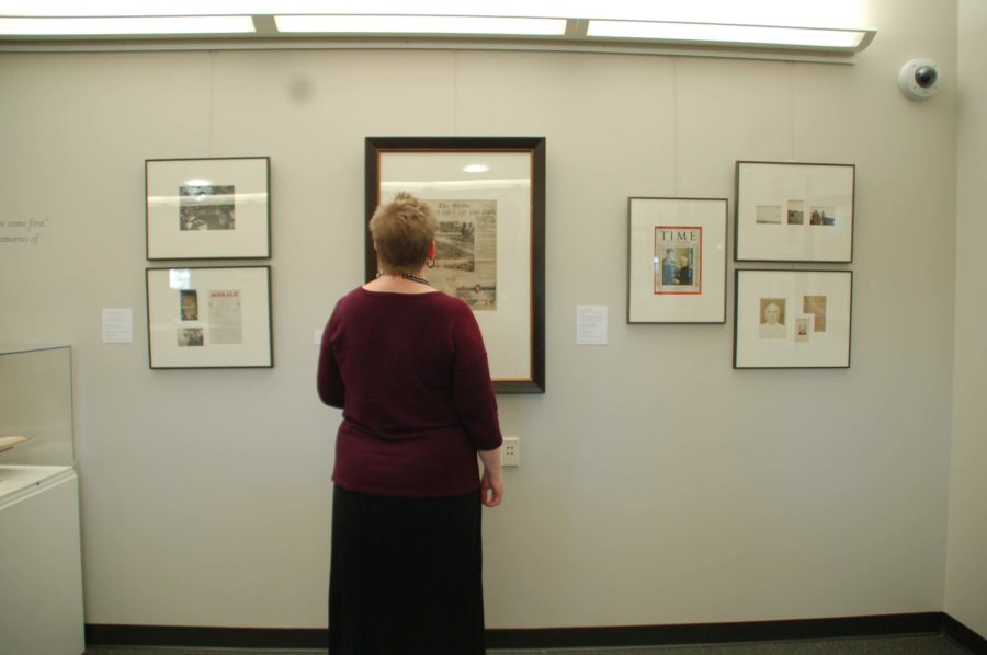 Rebecca+Donlan+of+Library+Services+admires+a+newspaper+clipping+during+the+opening+of+the+Uncommon+Friends+exhibit+in+the+library+room+322.+%28EN+photo%2FTaylor+Crehan%29