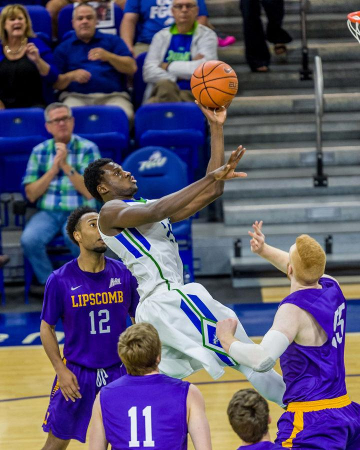 FGCU+forward+Marc-Eddy+Norelia+reaches+up+for+the+basket+during+Thursday+night%27s+conference+game+against+Lipscomb.+%28Photo+by+Linwood+Ferguson%29