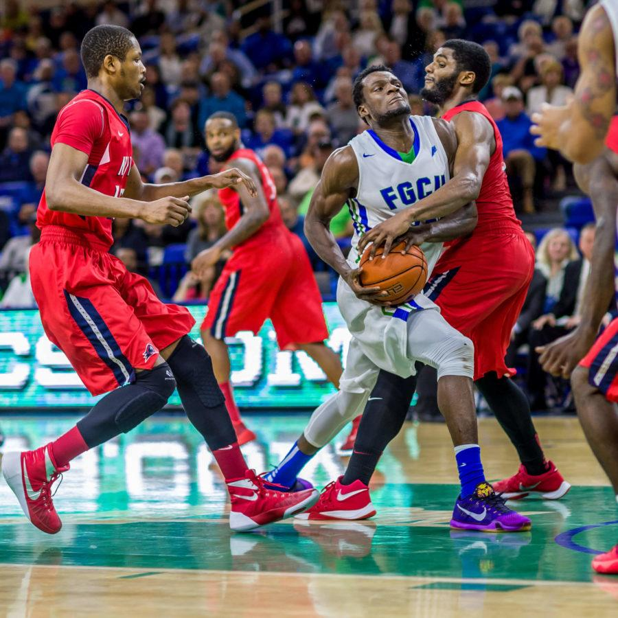 FGCU%27s+Marc-Eddy+Norelia+fights+for+possession+with+NJIT+players+in+the+Jan.+14+game+at+Alico+Arena.+%28Photo+by+Linwood+Ferguson%29