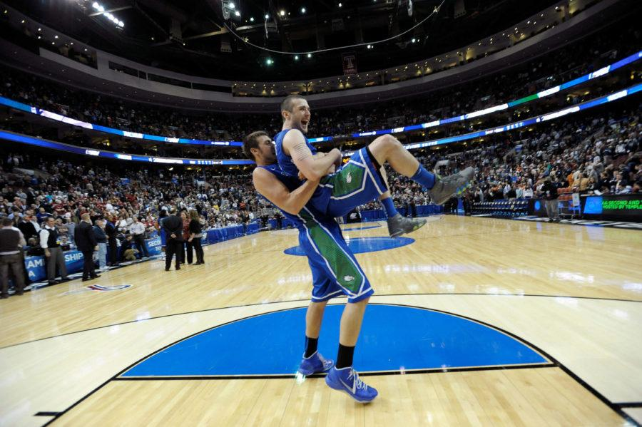 Florida Gulf Coasts Brett Comer, right, and Chase Fieler celebrate after defeating Georgetown 78-68 in a second-round game in the NCAA college basketball tournament on Friday, March 22, 2013, in Philadelphia. (AP Photo/Michael Perez)