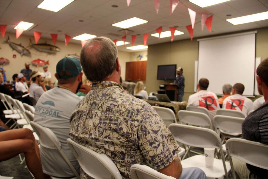The audience listens to captain Chris Wittman speak about the CFCWs recently launched PSAs and upcoming documentary. (EN Photo/ Nina Barbero)