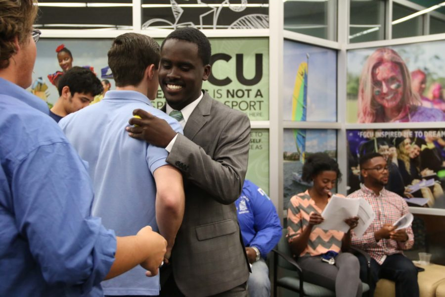 Thieldens Elneus hugs other members of Student Government following his reelection as FGCU's student body president. (EN Photo / Kelli Krebs)