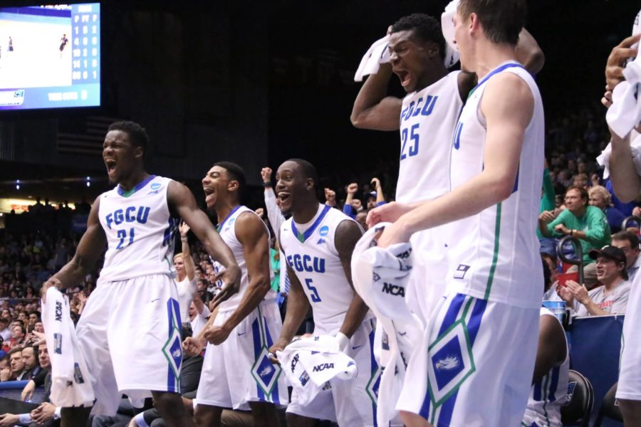 The+FGCU+men%27s+basketball+team+celebrates+a+dunk+from+Bryan+Greene+Jr.+in+the+final+minutes+of+the+First+Four+game+between+FGCU+and+Fairleigh+Dickinson+on+Tuesday.+%28EN+Photo+%2F+Kelli+Krebs%29
