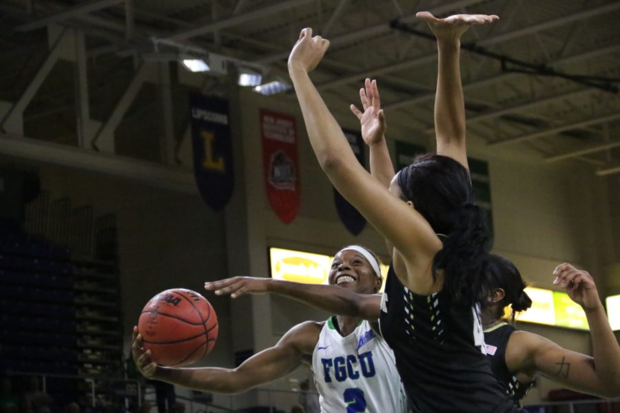 Kaneisha+Atwater+reaches+up+to+lob+the+ball+into+the+net+during+Monday+nights+WNIT+game+against+Wake+Forest+at+Alico+Arena.+%28EN+Photo+%2F+Kelli+Krebs%29