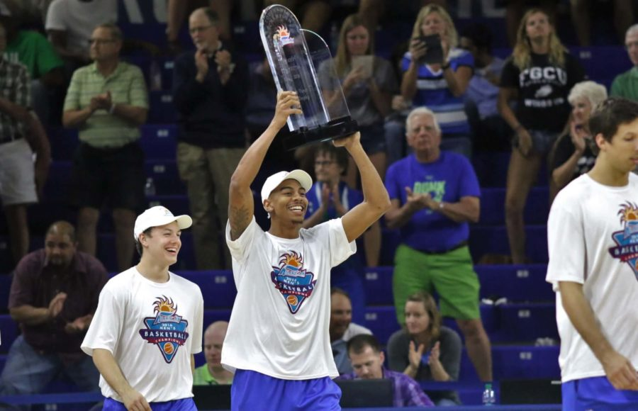 FGCU+senior+Julian+DeBose+lifts+the+Atlantic+Sun+Conference+Championship+trophy+during+halftime+of+the+womens+semifinal+game+when+the+team+was+honored+on+Wednesday+night.+%28EN+Photo+%2F+Kelli+Krebs%29