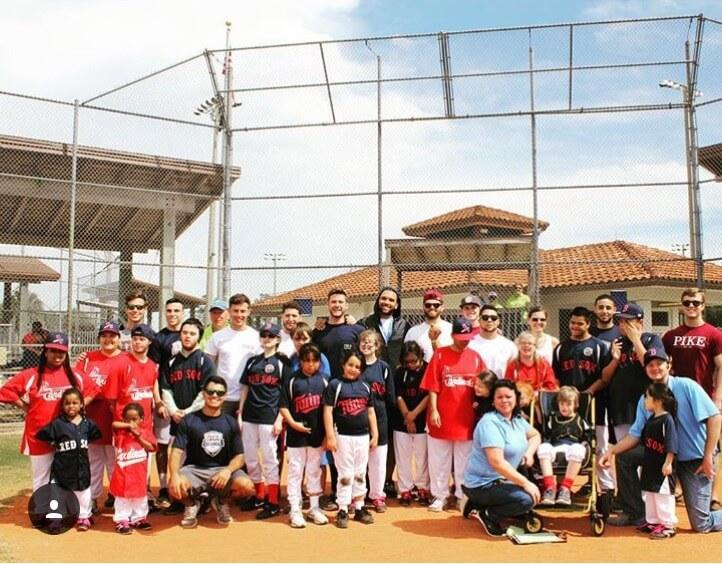 Pi Kappa Alpha makes a short stop and volunteers by playing baseball