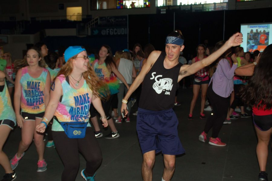Freshman Sierra Stevens (left) and sophomore Michael Rybak dance during the fourth annual FGCU Dance Marathon in Alico Arena on Saturday April 2. (EN Photo / Taylor Crehan)