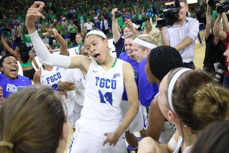 Whitney Knight (center) dances with the rest of the FGCU women's basketball team following Thursday night's win over Michigan at Alico Arena. (EN Photo / Kelli Krebs)