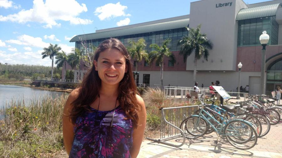 Sydney Thabet in front of the Library on campus.  Her life changed a lot since she started college, and after a rather lonely first semester, she is now involved with on-campus clubs and smartly balances her social life with her studies. (EN Photo/ Jaynie Tice)