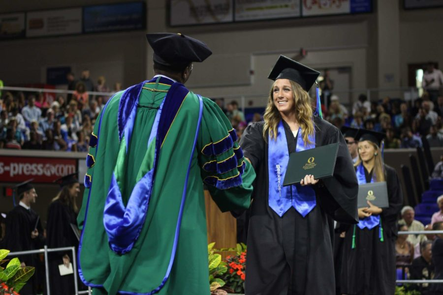 Jenna+Cobb+shakes+President+Wilson+Bradshaw%E2%80%99s+hand+as+she+gets+her+degree+in+the+spring+2015+commencement+ceremony.+Students+will+have+four+more+degrees+to+choose+from+starting+fall+2016.+%28EN+Photo%2F+Kelli+Krebs%29