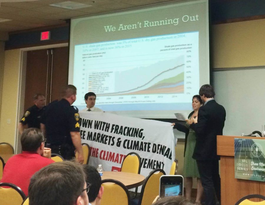 Activists Ellis and Musheyev were asked to leave the room by UPD officers, who were on stand by for the event. (Photo Special to Eagle News.)
