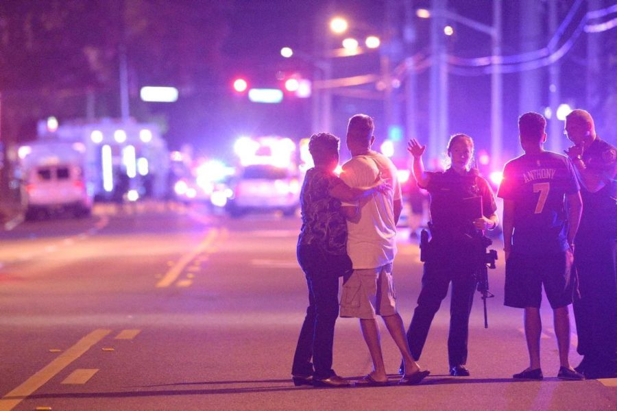 Orlando Police guide family members away from the crime scene in the early morning hours of Sunday, June 12. (AP Photo/Phelan M. Ebenhack)