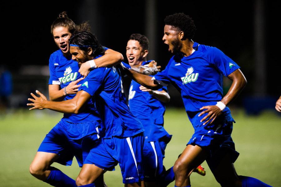 Teammates celebrate with FGCU defender Eli Roubos after scoring his first goal of the season. The game-tying goal ultimately led to FGCU's 3-2 win over inner-state rival USF. (EN Photo / Brad Young)