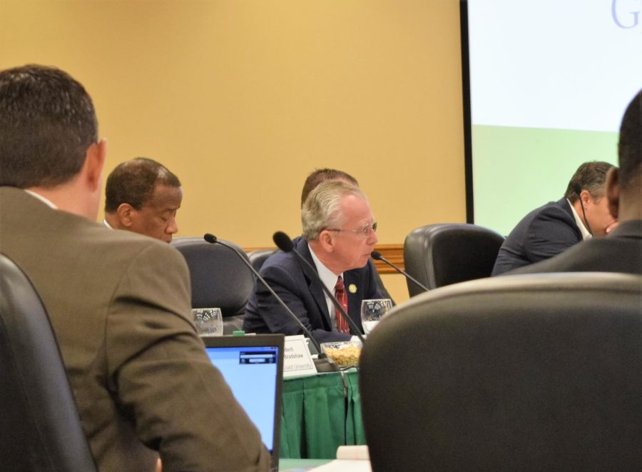 Board+of+Trustees+Chair+Dudley+Goodlette+speaks+into+his+microphone+during+the+last+BOT+meeting+of+the+year+on+Friday%2C+Dec.+9.+