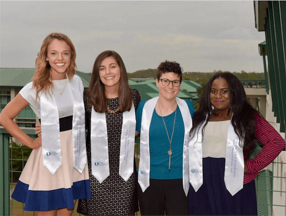 Four students awarded the Excellence in Civic Engagement stole