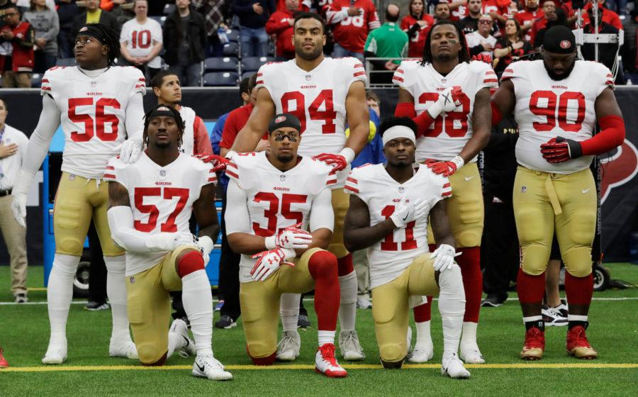 AP+FILE+PHOTO+%2F%2F+In+this+Dec.+10%2C+2017%2C+file+photo%2C+San+Francisco+49ers+Eli+Harold+%2857%29%2C+Eric+Reid+%2835%29+and+Marquise+Goodwin+%2811%29+kneel+during+the+national+anthem+before+a+game.