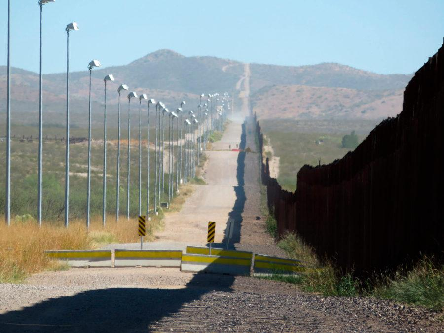 AP File Photo // In this Nov. 15, 2016, photo, stadium lights atop tall poles oversee a pedestrian barrier stretching for miles along a section of the border wall between Douglas, Arizona, and Agua Prieta, in the Mexican state of Sonora.