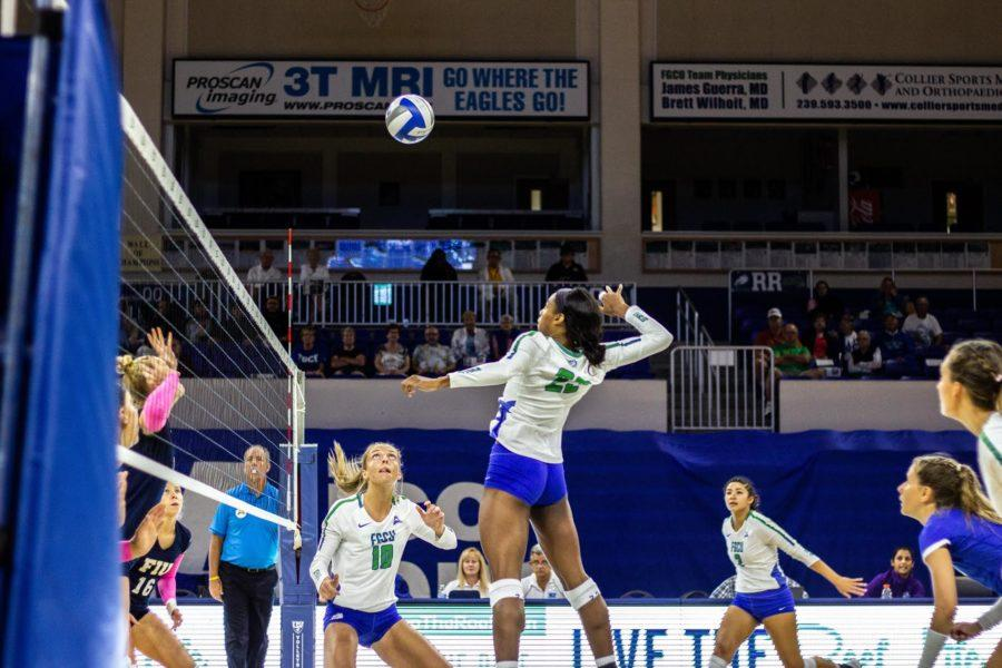 Photo+by+Alex+Barrio+%2F%2F+Chelsey+Lockey+sets+up+Tori+Morris+for+a+kill.+Lockey+was+one+of+three+who+scored+an+ace+in+the+Eagles+win+over+FIU+Tuesday+night.+Next%2C+the+team+will+host+North+Alabama+on+Friday%2C+Oct.+26.+