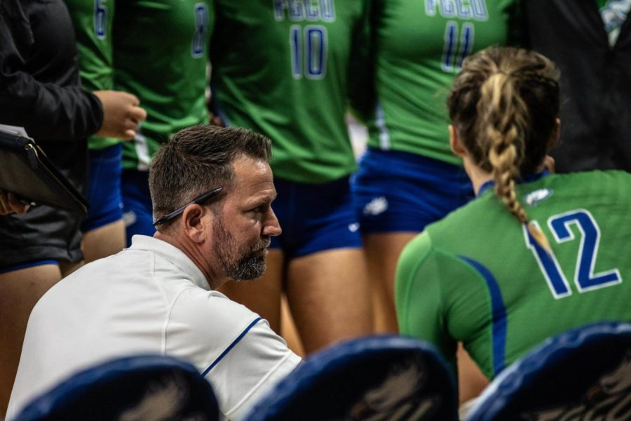 EN Photo by Bret Munson // Volleyball coach Matt Botsford talks to his players on the bench during a match at home. Botsford reached 100 wins with FGCU when the Eagles shut out North Alabama on Sunday.