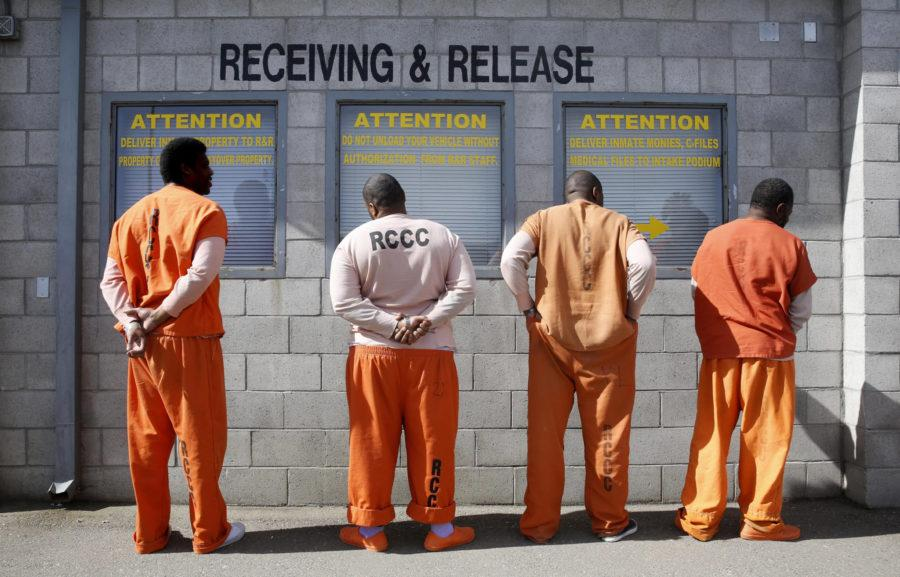 FILE - In this Feb. 20, 2014, file photo, prisoners from Sacramento County await processing after arriving at the Deuel Vocational Institution in Tracy, Calif. One amendment in the upcoming election will decide if ex-felons get the right to vote. (AP Photo/Rich Pedroncelli, file)