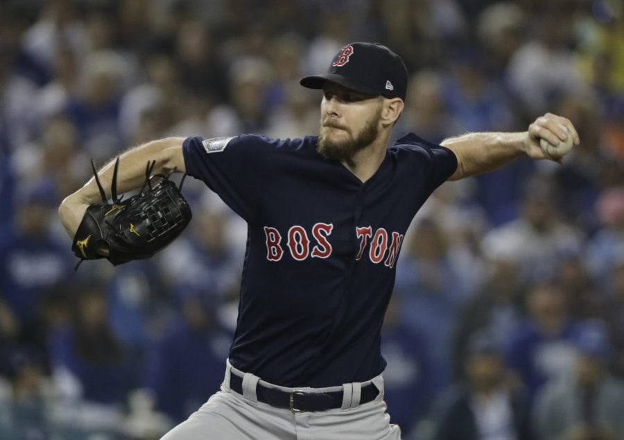Boston Red Sox pitcher Chris Sale throws during the ninth inning in Game 5 of the World Series baseball game against the Los Angeles Dodgers on Sunday, Oct. 28, 2018, in Los Angeles. (AP Photo/David J. Phillip)