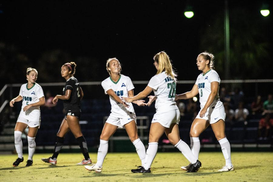 EN Photo by Bret Munson // The FGCU womens soccer team celebrates during a game against Weber International. Five players were selected for the All-ASUN team.
