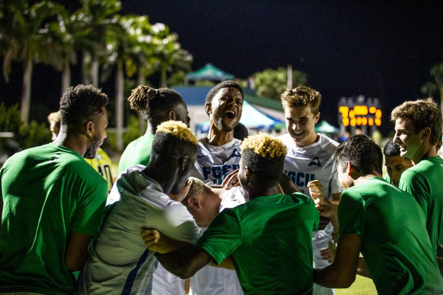 EN+Photo+by+Bret+Munson+%2F%2F+The+FGCU+men%27s+soccer+team+celebrates+a+goal+at+an+evening+home+game