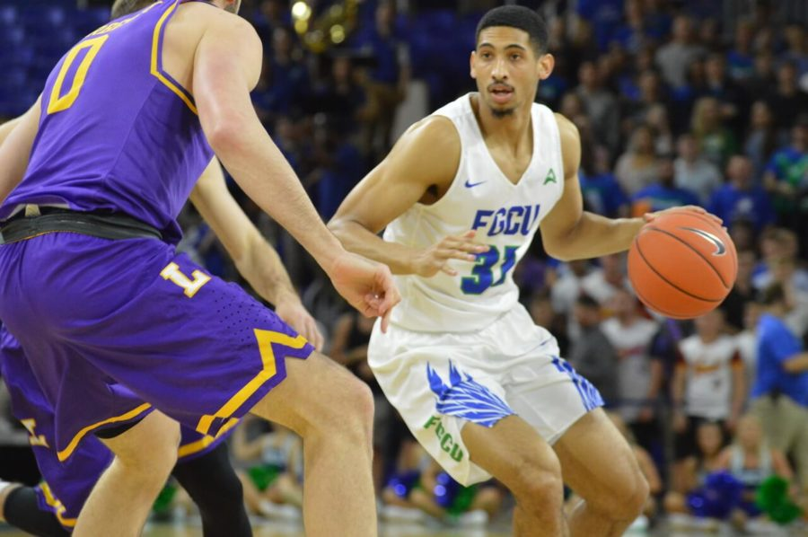 FGCU+men%27s+basketball%27s+Dinero+Mercurius+looks+to+pass+a+defender+during+a+home+game+against+Lipscomb+earlier+in+the+season.