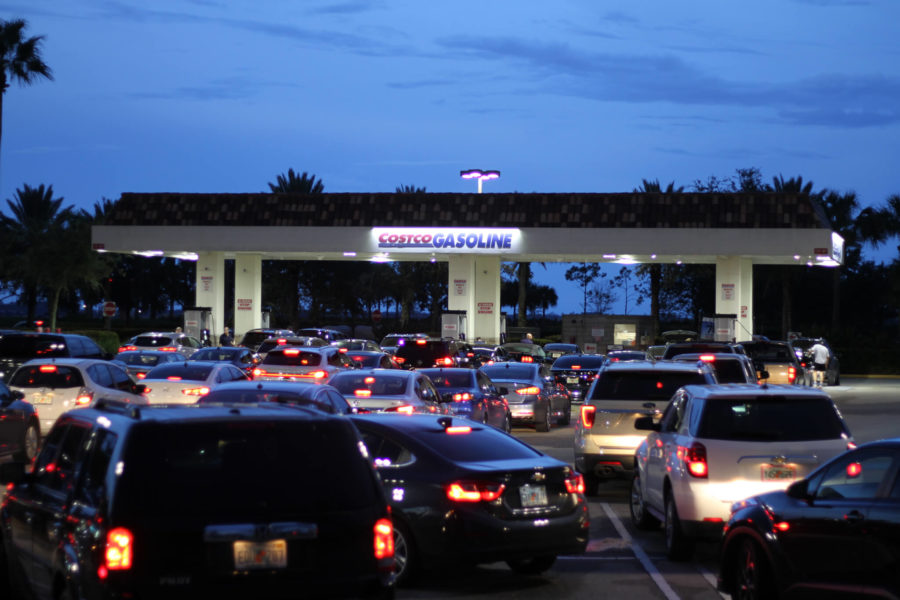 About 40 people line up for gas at the Costco in Gulf Coast Town Center. Some customers were waiting for an hour.