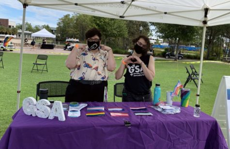Gender & Sexuality Alliance Campus Outreach Frances Elmore (left) and Executive Board Member Lukas (right) table at the Pride parade & block party. EN Photo by Nina Mendes.