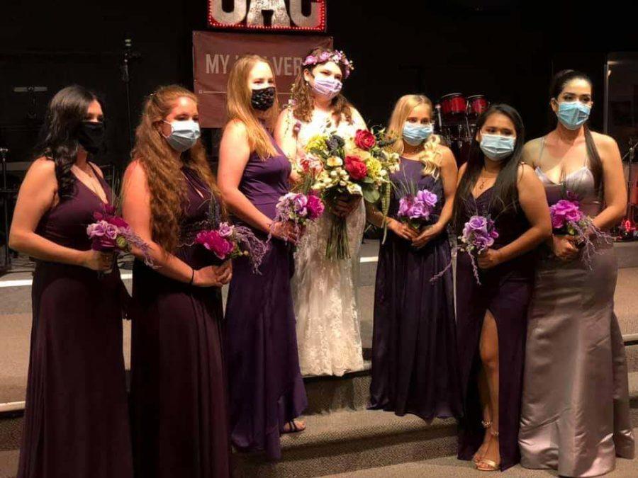 Katie+Loudermilk+standing+with+her+bridesmaids+in+masks.