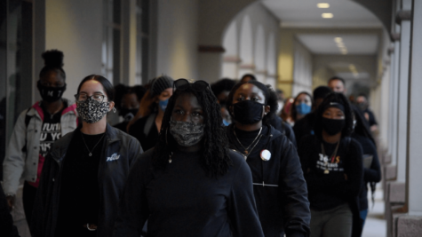 Students march past Reed Hall in student protest
